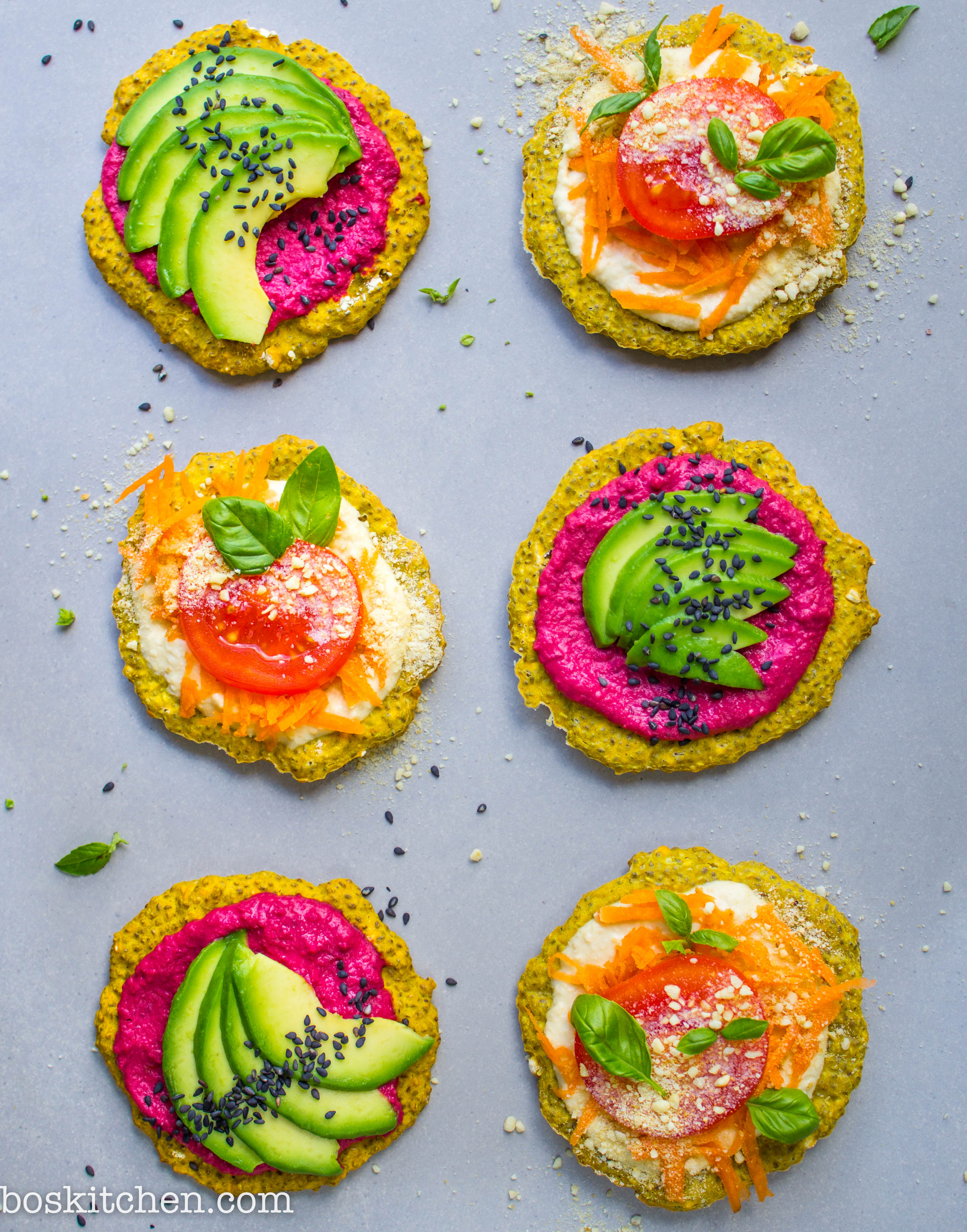 sunshine pizzas with chia and maca and turmeric topped with humous and avocado and grated carrot